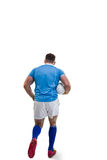 Rugby player running with the ball Stock Photography