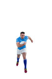 Rugby player running with the ball Royalty Free Stock Photography