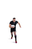 Rugby player running with the ball Royalty Free Stock Photos