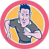 Rugby Player Running Charging Circle Cartoon. Illustration of a rugby player running with the ball charging viewed from front done in cartoon style on isolated Royalty Free Stock Images