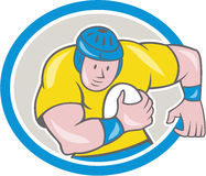 Rugby Player Running Charging Circle Cartoon. Illustration of a rugby player running with the ball charging viewed from front set inside circle done in cartoon Stock Photos