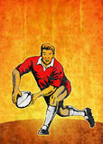 Rugby player running passing ball Royalty Free Stock Photo