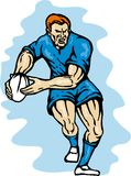 Rugby player running passing the ball Royalty Free Stock Images
