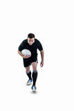 Rugby player running with the rugby ball Royalty Free Stock Image