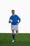 Rugby player running with the rugby ball Royalty Free Stock Photo