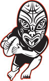 Rugby player running wearing Maori mask Stock Image