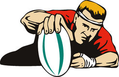 Rugby player scoring a try Stock Photo
