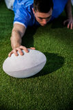 A rugby player scoring a try Stock Photos