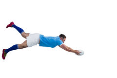 Rugby player scoring a try Stock Photos