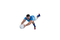 Rugby player scoring a try Stock Photography