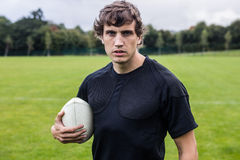 Rugby player scowling at camera Royalty Free Stock Photography