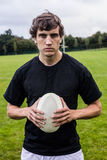 Rugby player scowling at camera Royalty Free Stock Photo