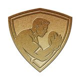 Rugby player shield metallic gold Royalty Free Stock Image
