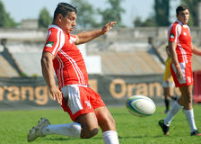 Rugby player shoots the ball in Dinamo Bucharest-CSM Bucharest. Dinamo player pictured in action during the Romanian SuperLeague play off game between Dinamo stock photos
