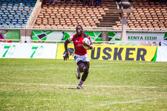 Rugby player sprinting. Kenya's Shujaa beats Simba Saba 17-14 during the Safaricom Sevens Rugby tournament held at the Safaricom Stadium Kasarani on September stock image