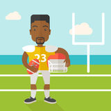 Rugby player on stadium. An african-american rugby player with ball and helmet in hands standing on the stadium vector flat design illustration. Square layout Royalty Free Stock Images
