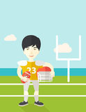 Rugby player on stadium. An asian rugby player with ball and helmet in hands standing on the stadium vector flat design illustration. Vertical poster layout with Royalty Free Stock Photo