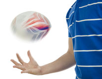 Rugby player throwing ball in the air Stock Photography