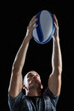 Rugby player throwing ball Royalty Free Stock Image