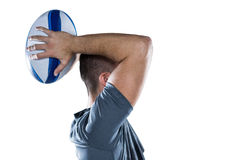 Rugby player throwing ball Stock Photos