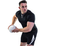 Rugby player throwing the ball Stock Photography