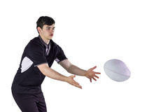 Rugby player throwing a rugby ball Stock Images