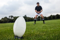 Rugby player about to kick ball Stock Image