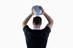Rugby player about to throw a rugby ball Stock Images