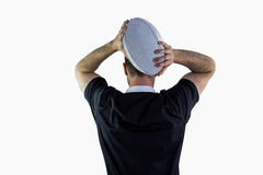 Rugby player about to throw a rugby ball Royalty Free Stock Photography
