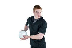 Rugby player about to throw a rugby ball Royalty Free Stock Image