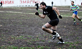 Rugby players in action Stock Image