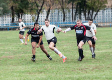 Rugby players in action Stock Images