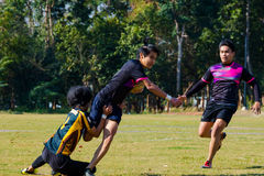 Rugby players in action Stock Photo