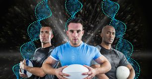 Rugby players with blue DNA chains in a black with lights background Royalty Free Stock Photo