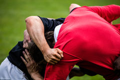 Rugby players doing a scrum. At the park Stock Photo