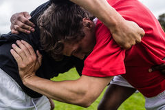 Rugby players doing a scrum Stock Photos