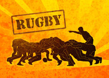 Rugby players engaged in scrum Stock Images
