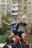Rugby players fight for ball Royalty Free Stock Images