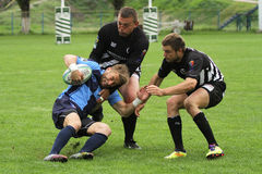 Rugby players fight for ball Royalty Free Stock Photos