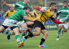 Rugby players fight for ball. Rugby players pictured in action during the Amlin Challenge Cup game between Bucharest Wolves and Newcastle Falcons stock image