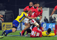 Rugby players fight for ball Stock Photo
