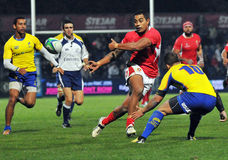 Rugby players fight for ball. Rugby players pictured in action during the game between Romania and Tonga stock image