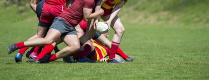 Rugby players fight for the ball on professional rugby stadium.  royalty free stock images