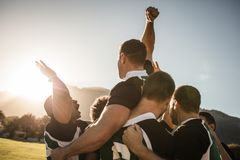 Rugby team celebrating the victory. Rugby players lifting the teammate after winning the game. Rugby team celebrating the victory royalty free stock photos
