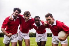 Rugby players putting hands together Stock Photos