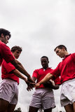 Rugby players putting hands together Royalty Free Stock Photo