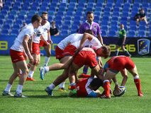 Rugby players. Pictured in action during a game between Poland and Russia counting for Rugby 7`s GP which took place in Bucharest Royalty Free Stock Photo
