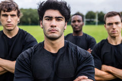 Rugby players scowling at camera Stock Photo