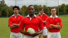 Rugby players standing together stock footage