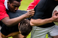 Rugby players tackling during game. At the park Royalty Free Stock Photos